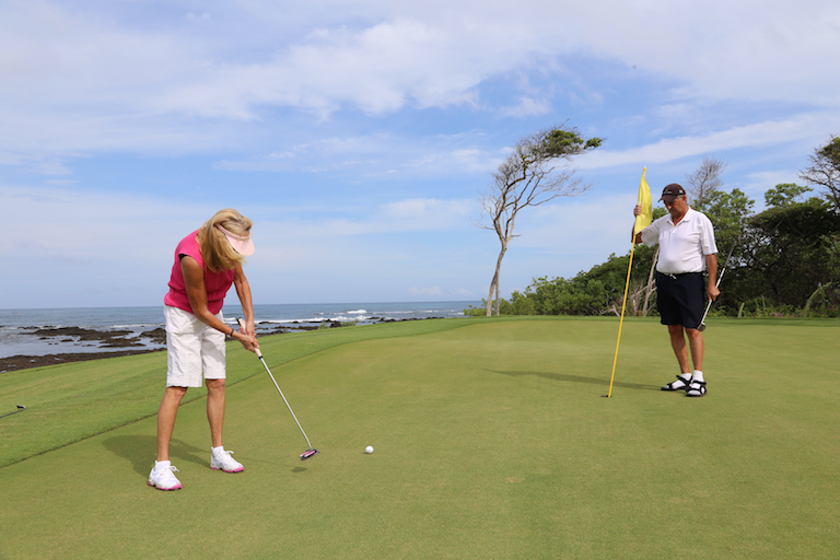 Putting on the green at Hacienda Pinilla Golf Course