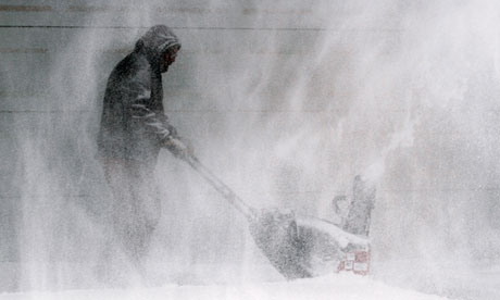 A man clears snow from a house in Wichita, Kansas