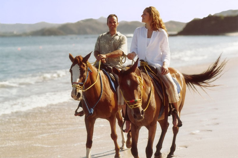 Living in Costa Rica includes riding horses on the beach 89