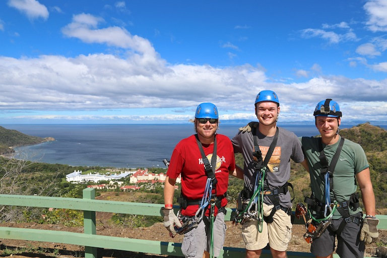 Mike Simons & friends wearing zipline gear in Costa Rica