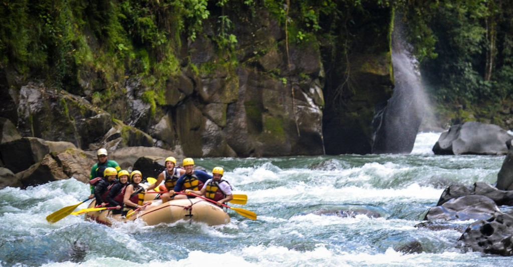 Large group of people white water rafting in Costa Rica